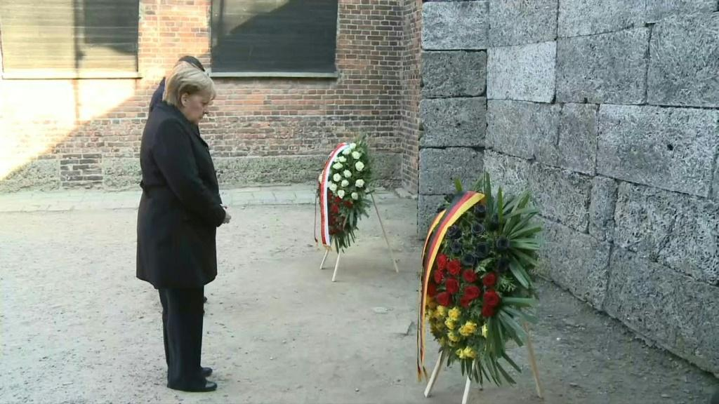 """Angela Merkel pays tribute to Holocaust victims at the """"Death Wall"""" in the former German Nazi death camp Auschwitz"""