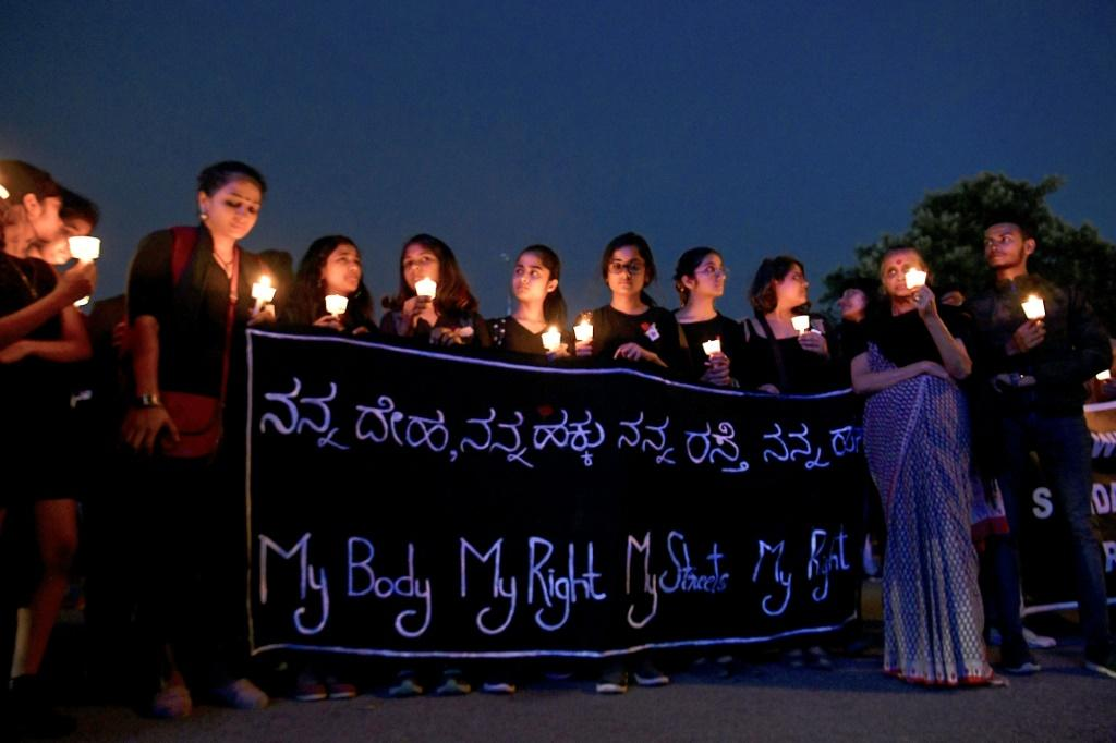 People in Bangalore hold a candlelight vigil in support of sexual assault victims and against the alleged rape of a veterinary doctor, on December 6
