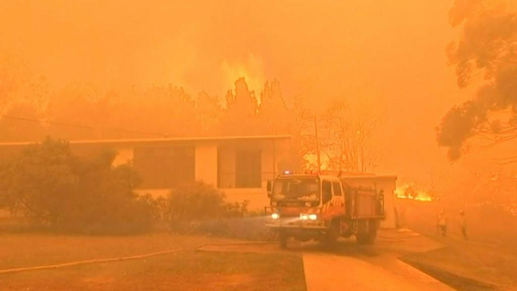 "Several Australian bushfires have combined to form a ""mega fire"" that is burning out of control across a swathe of land north of Sydney."