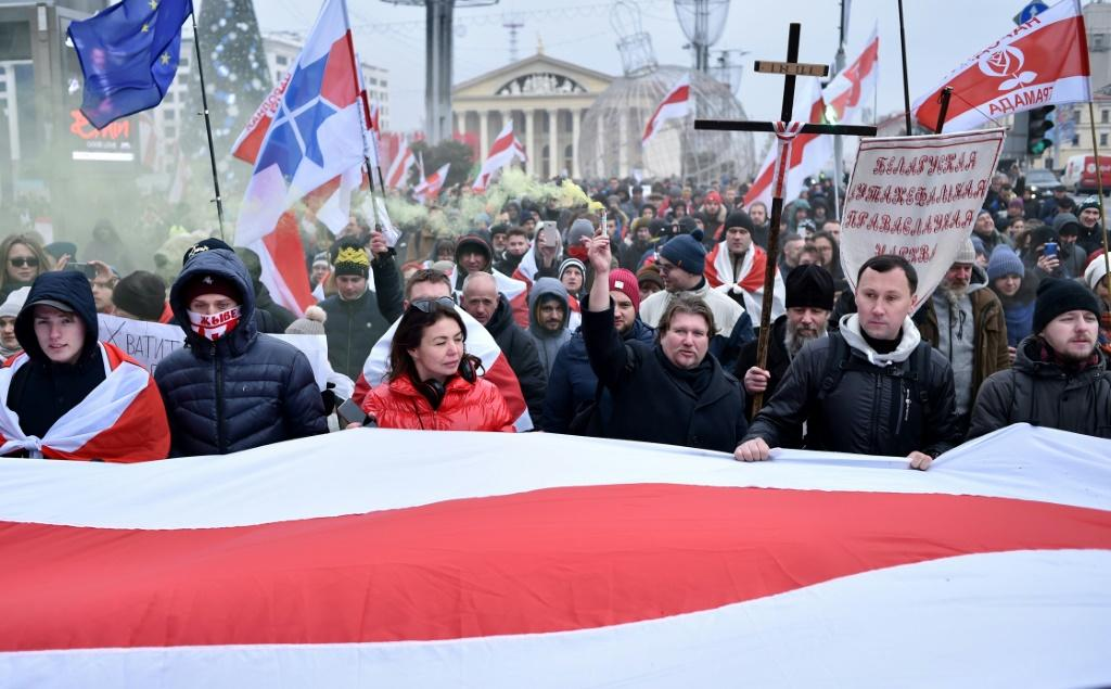Belarusian protesters march in the capital Minsk against the prospect of closer ties with Russia