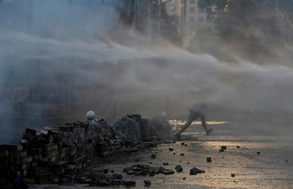 Some protesters armed with stones and Molotov cocktails clashed with police, who scattered them with tear gas and water cannon