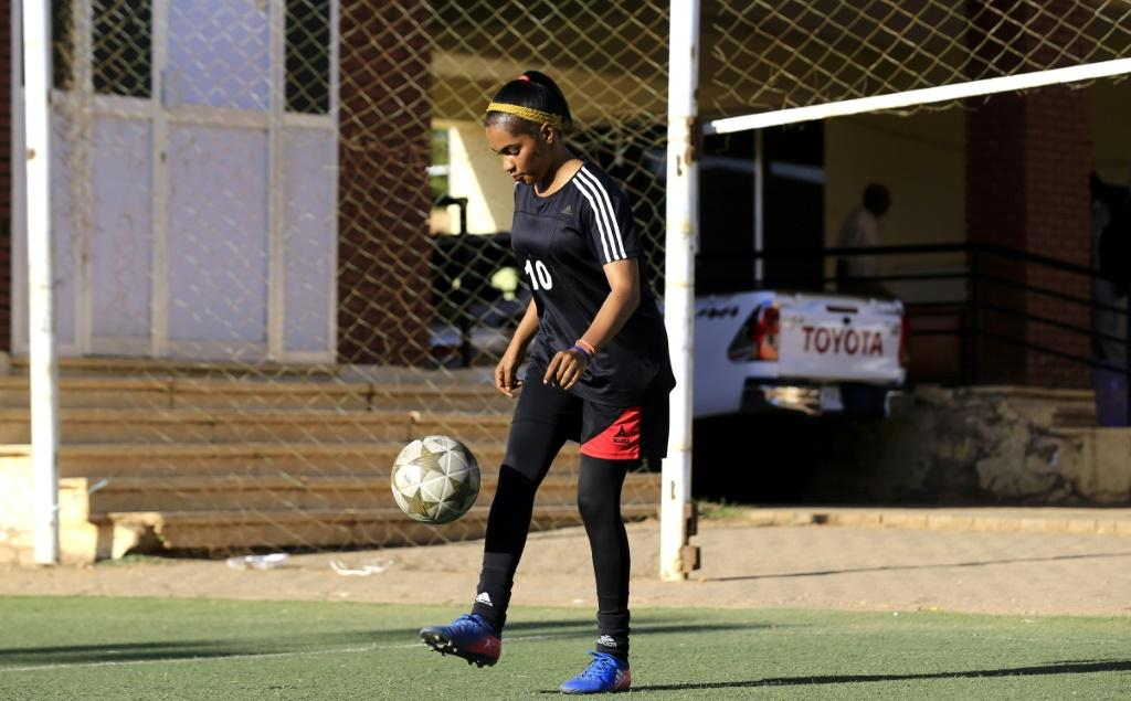 """Sudanese footballerr Rayan Rajab, 22, has played the the game since she was young and says, """"my parents had no objection, they kept telling me to push on with sports"""