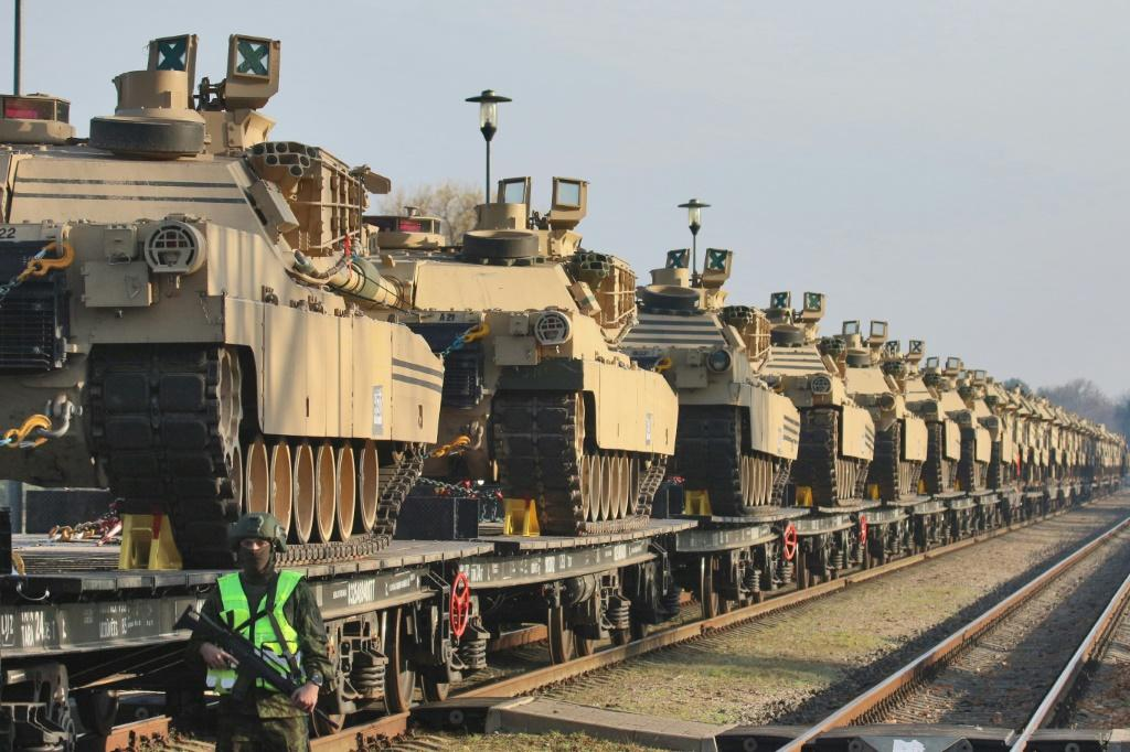 US Abrams tanks at a railway station near a military base in Lithuania, on October 21, 2019: the US Army is preparing its largest deployment of troops to Europe in 25 years, part of a show of force during rising tensions with Russia