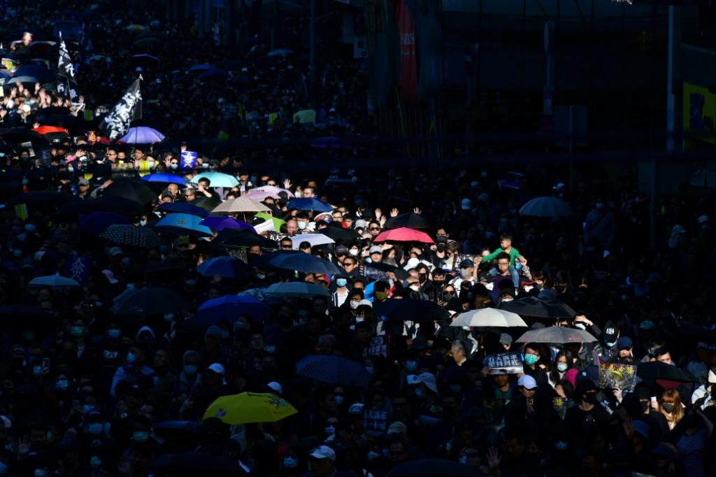 Around 800,000 people marched peacefully through Hong Kong's streets on December 9, urging the government to respond to their five demands