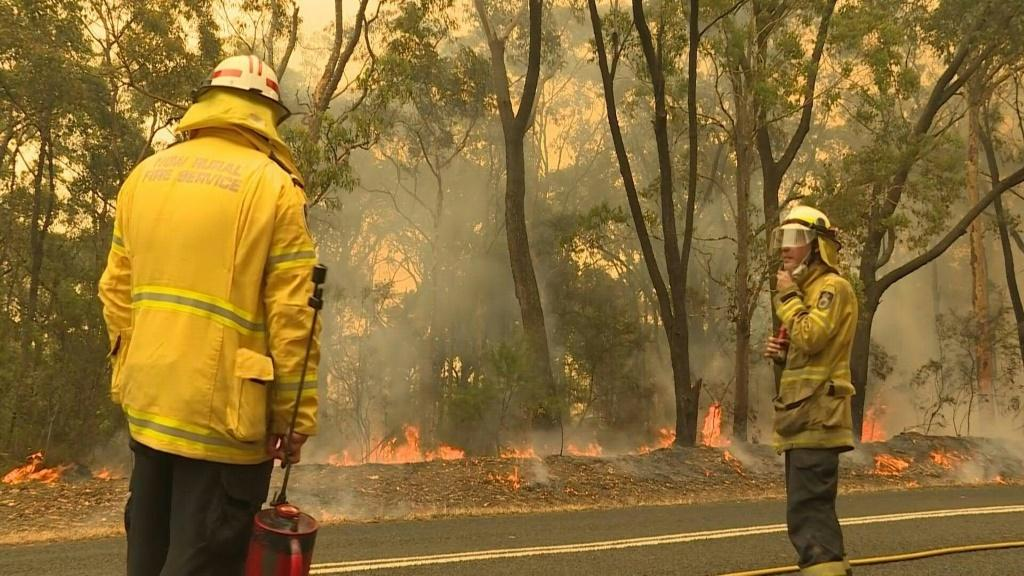 Firefighters in Australia battle an out of control fire amid scorching conditions as the east coast continues to blaze on Tuesday