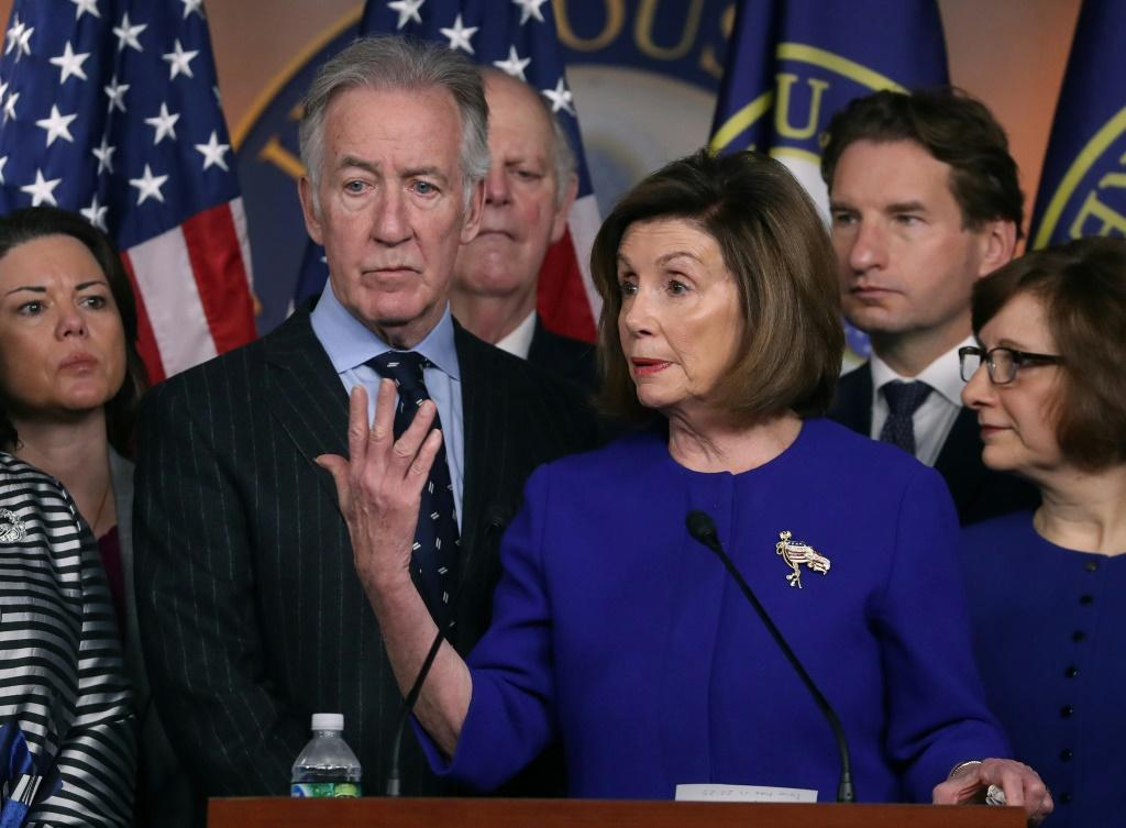 House Speaker Nancy Pelosi and Ways and Means Chairman Richard Neal (L) announce a deal on the USMCA trade agreement