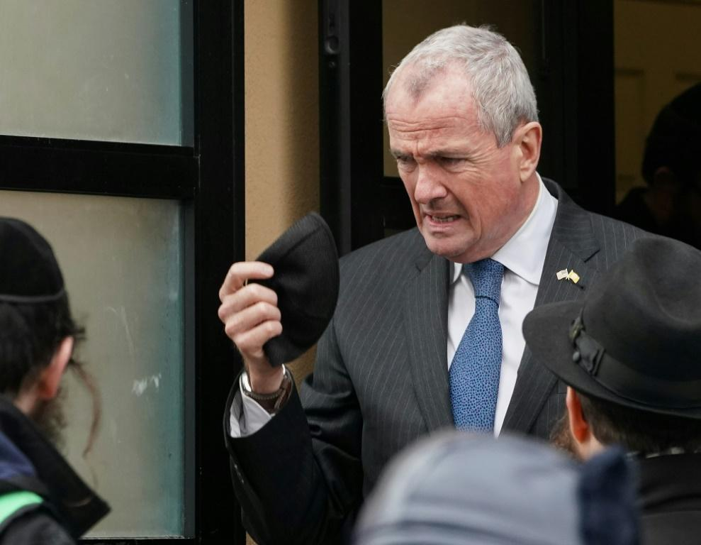 New Jersey Governor Phil Murphy visits the scene of a shooting at a Jewish deli