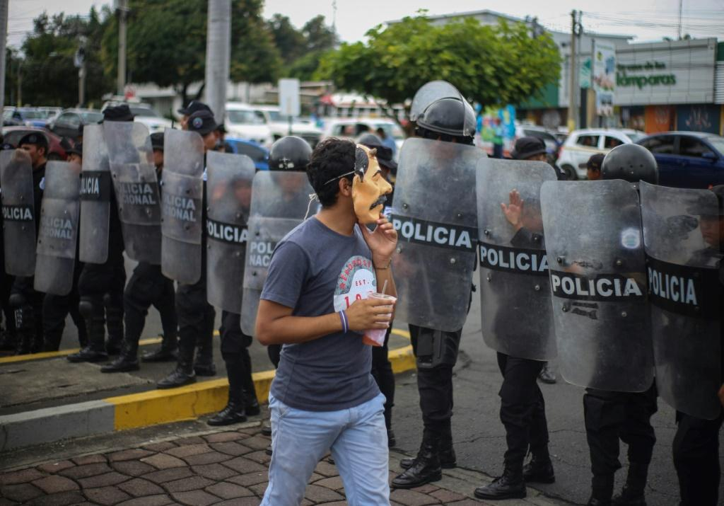 An anti-government protester wears a mask depicting Nicaraguan President Daniel Ortega on October 31, 2019