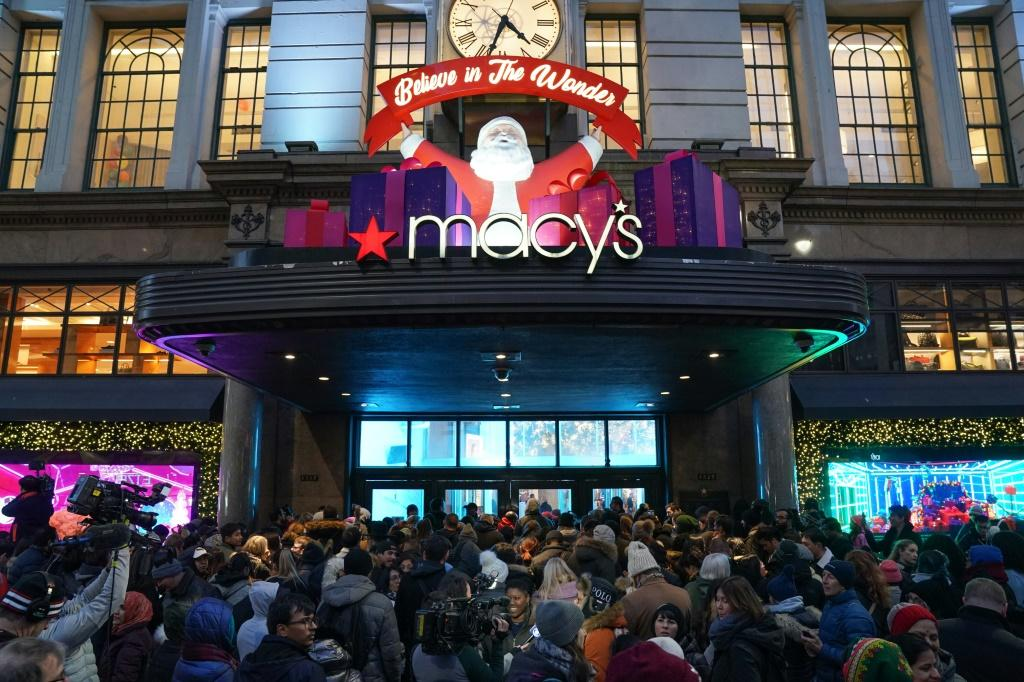 Shoppers wait to enter a Macy's department store on Thanksgiving Day. Department store sales fell 0.6 percent in November 2019