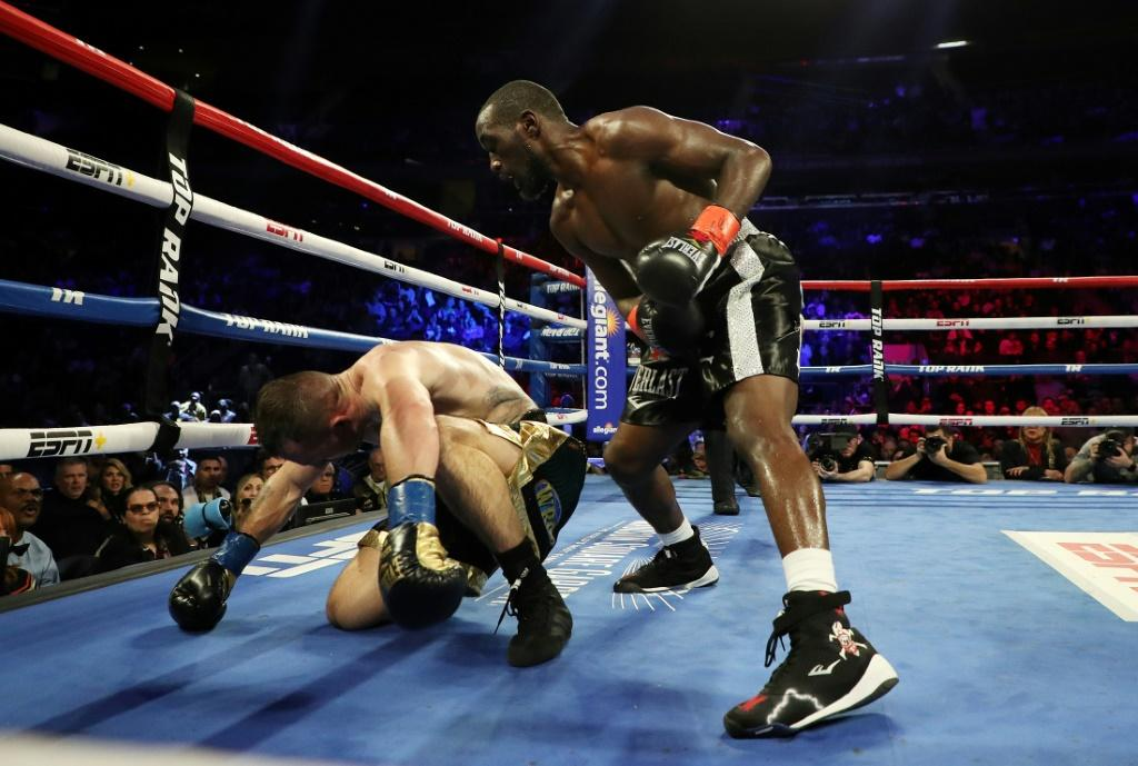 Terence Crawford knocks down Lithuania's Egidijus Kavaliauskas during their world title bout at Madison Square Garden