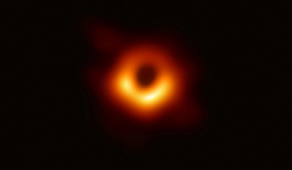 "A handout photo provided by the European Southern Observatory on April 10, 2019 shows the first photograph of a black hole and its fiery halo -- touted as the ""most direct proof of their existence"" by one of the project's lead scientists"