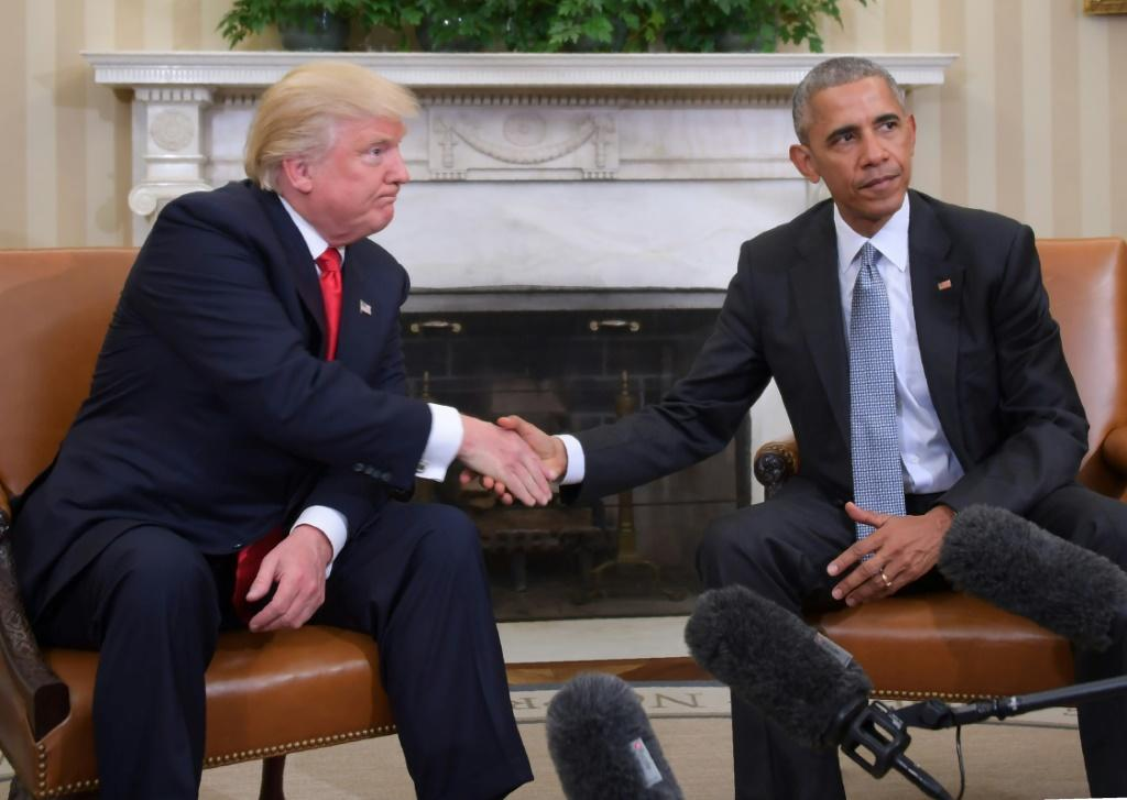 The White House transition from Barack Obama to Donald Trump (the pair are seen here after Trump's election in November 2016) has been one of the most stark in US history