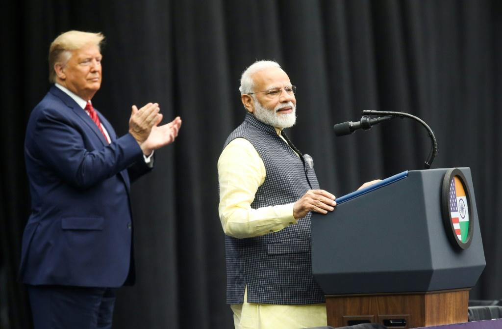 US President Donald Trump claps for Indian Prime Minister Narendra Modi as they address a joint rally in Houston in September 2019 -- their top ministers are set to meet in Washington