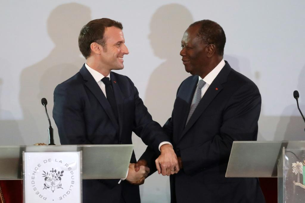 Handshake: Macron and Ouattara at their press conference in Abidjan last Saturday