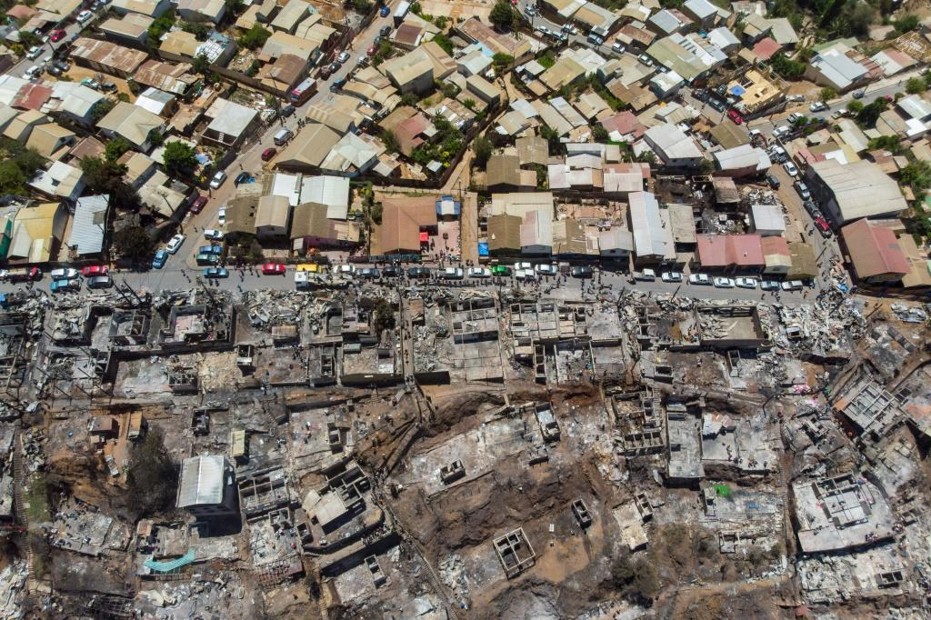 Aerial view of burned houses after a forest fire on Rocuant hill in Valparaiso, Chile, on December 25, 2019