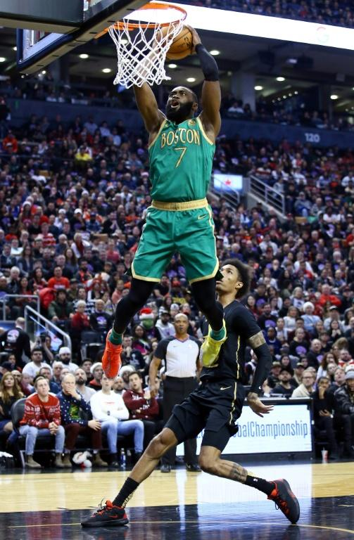 Boston's Jaylen Brown dunks on the way to scoring 30 points in the Celtics' 118-102 NBA victory over the Raptors in Toronto