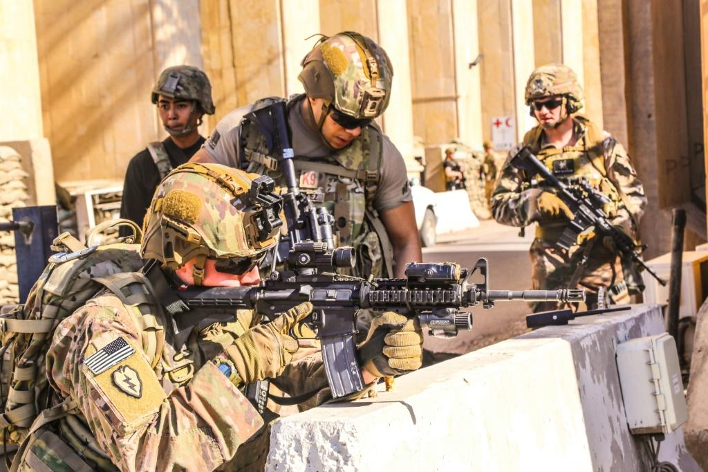 American soldiers take positions around the United States embassy in Baghdad, Iraq after supporters and members of the Hashed al-Shaabi military network breached the outer wall of the mission