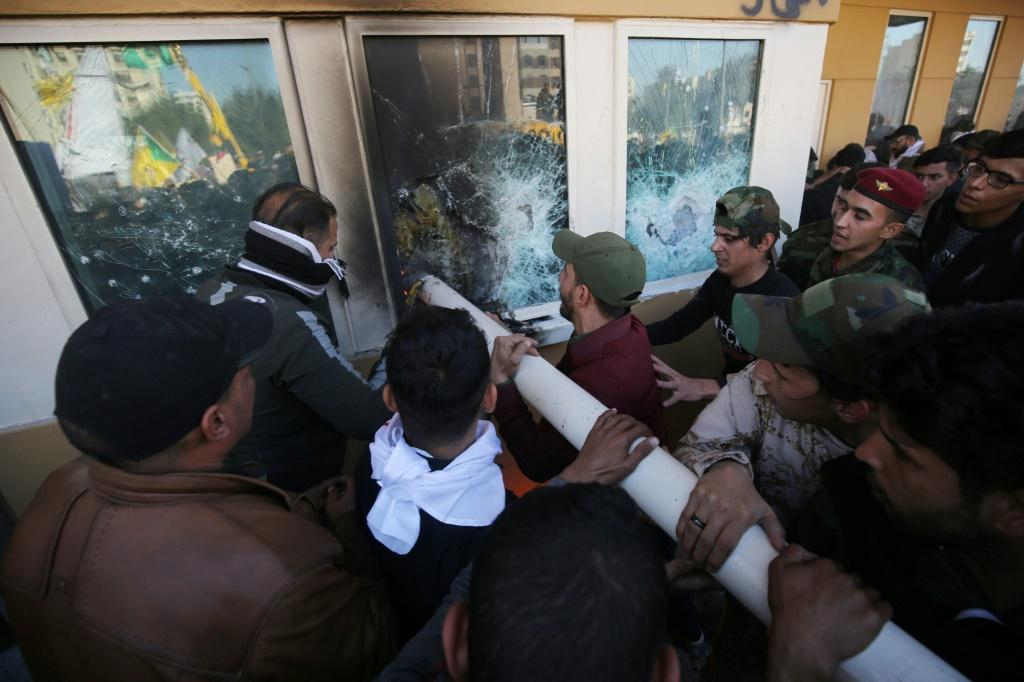 Iraqi protesters attacking the US embassy in Baghdad