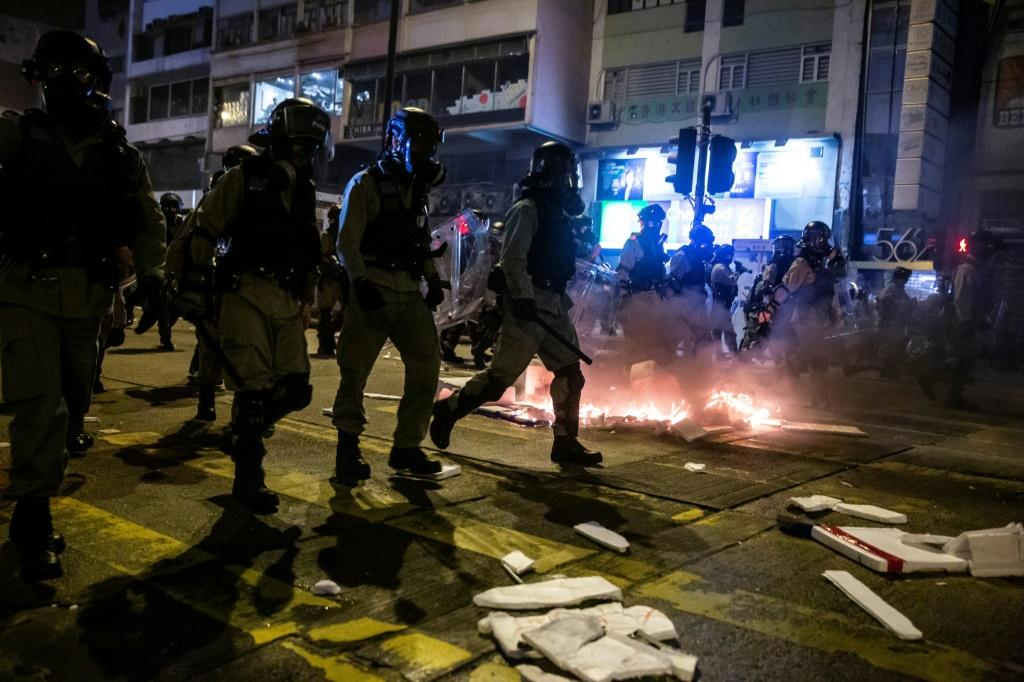 Peaceful protests on New Year's Eve morphed into tear gas-choked clashes between the police and hardcore demonstrators