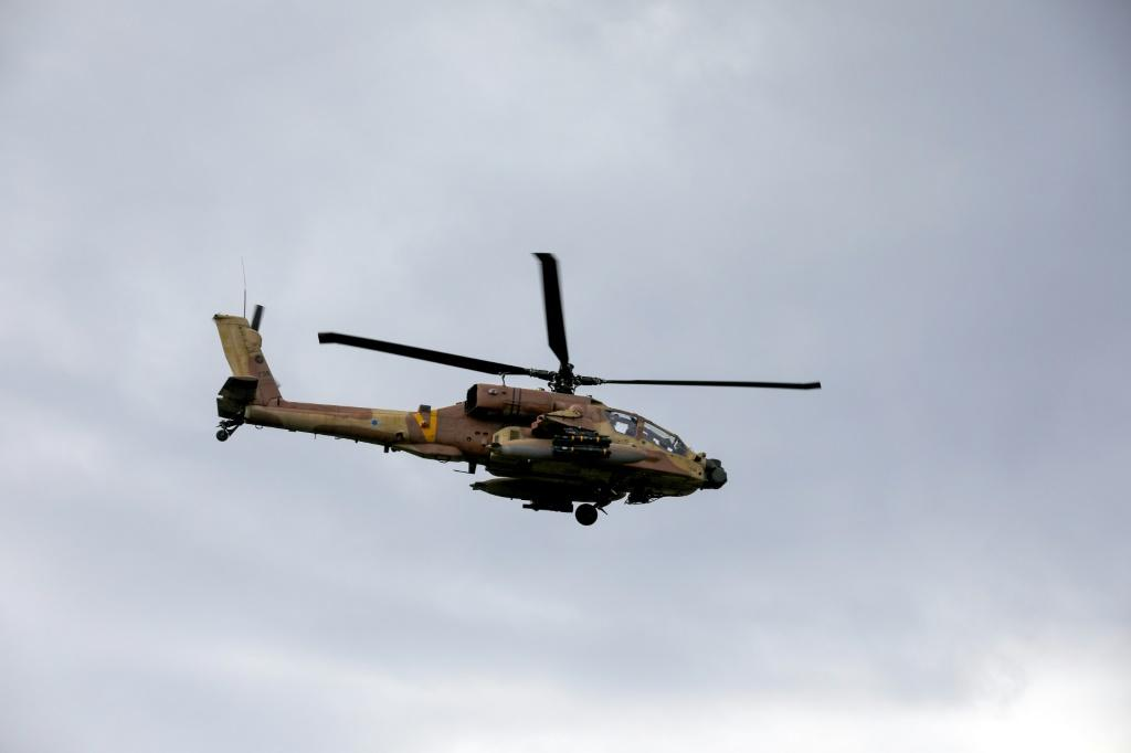 An Israeli army helicopter flies over the annexed Golan Heights
