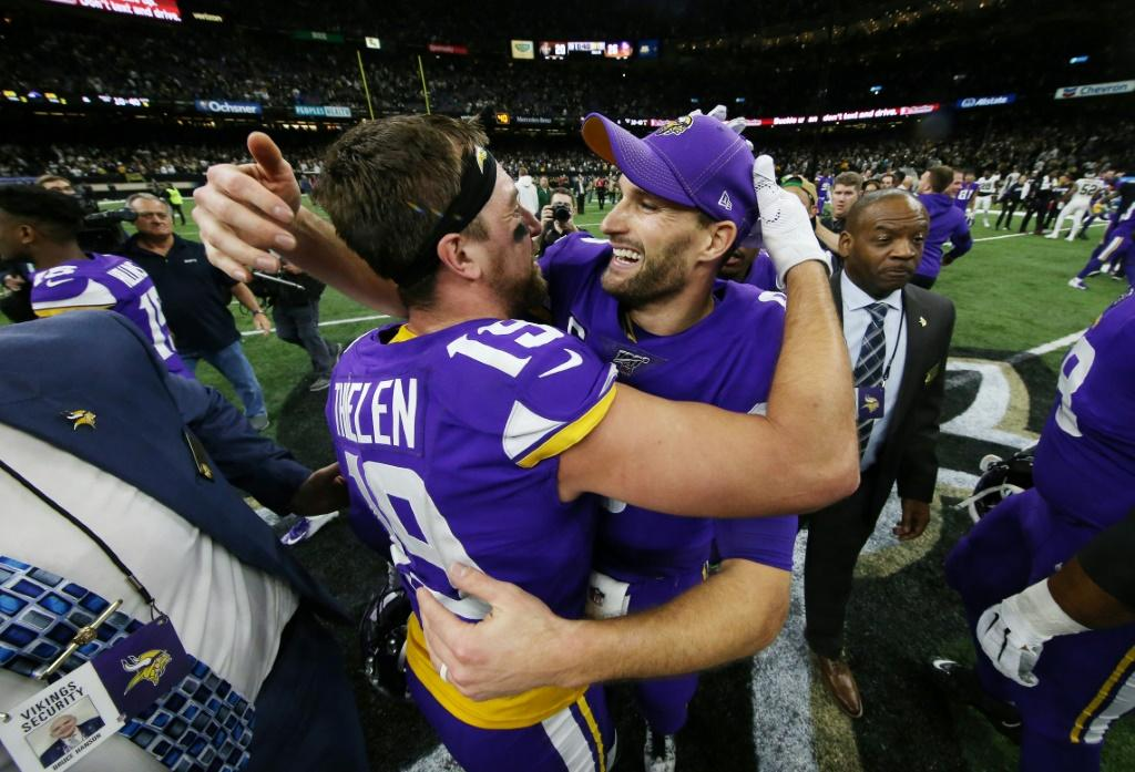Minnesota Vikings quarterback Kirk Cousins, right, celebrates with Adam Thielen, left, after the Vikings defeated the New Orleans Saints 26-20 in the NFL playoffs Sunday