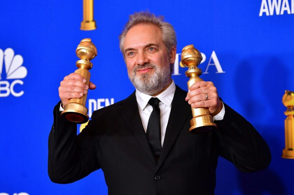 "British film director Sam Mendes poses in the press room with his two Golden Globes for war epic ""1917"