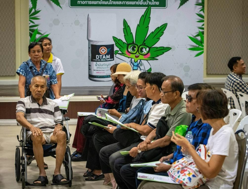 Patients wait to register for treatment at the opening of a medical marijuana clinic in Bangkok
