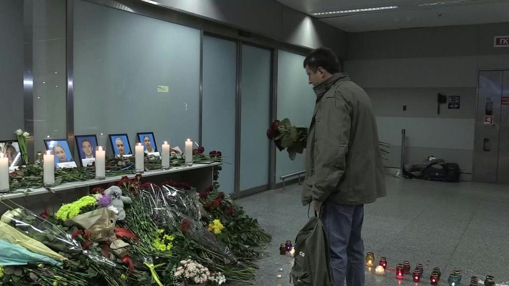 IMAGESUkrainians mourn the victims of the crash of a Ukraine International Airlines aircraft, laying flowers at a makeshift memorial at the plane's intended destination, Boryspil International Airport outside Kiev. The airliner crashed after take-off from
