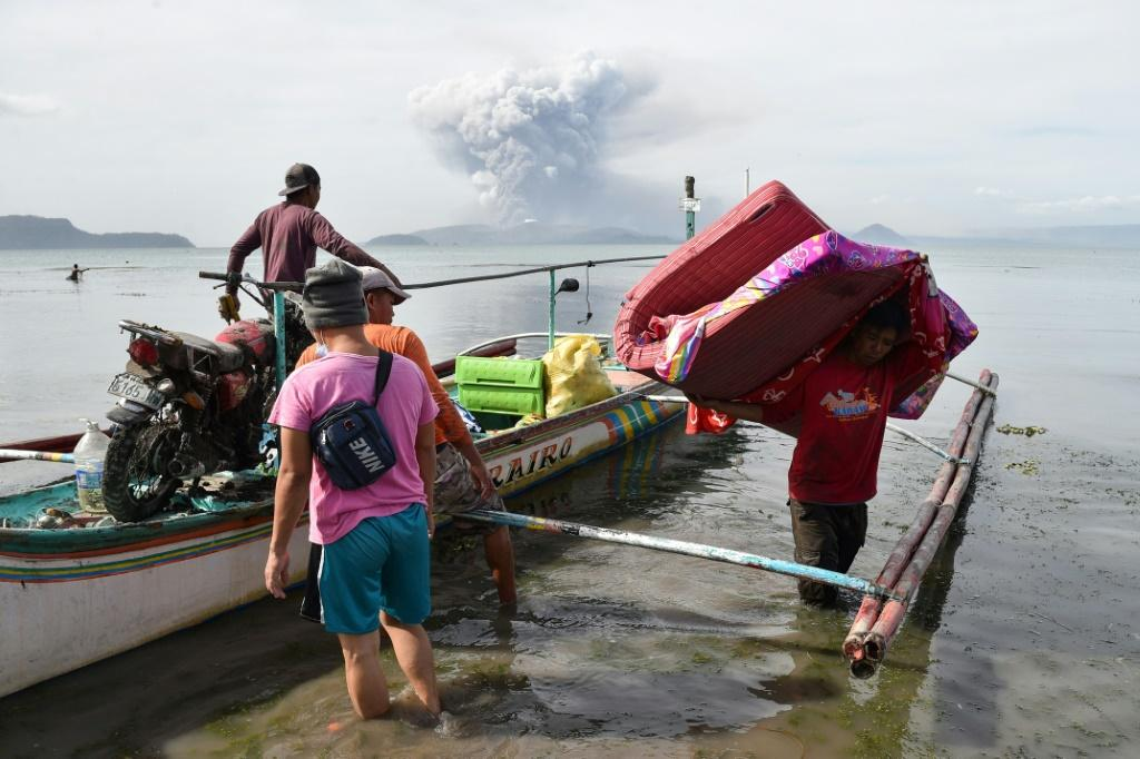 At least 10,000 people have sought refuge in evacuation centres as homes and streets near Taal were coated in fine grit