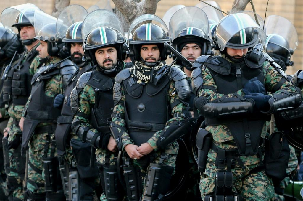 Iranian security forces in front of the British embassy in the capital Tehran during demonstrations following the British ambassador's arrest for allegedly attending an illegal demonstration