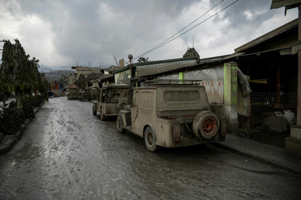 Vehicles covered in ash in Talisay town, south of Manila
