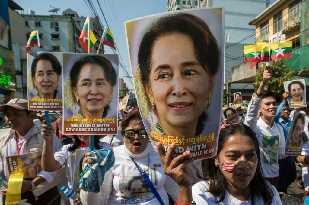 Demonstrators rally in Yangon in support of Myanmar leader Aung San Suu Kyi before her defence of the country at the UN in December