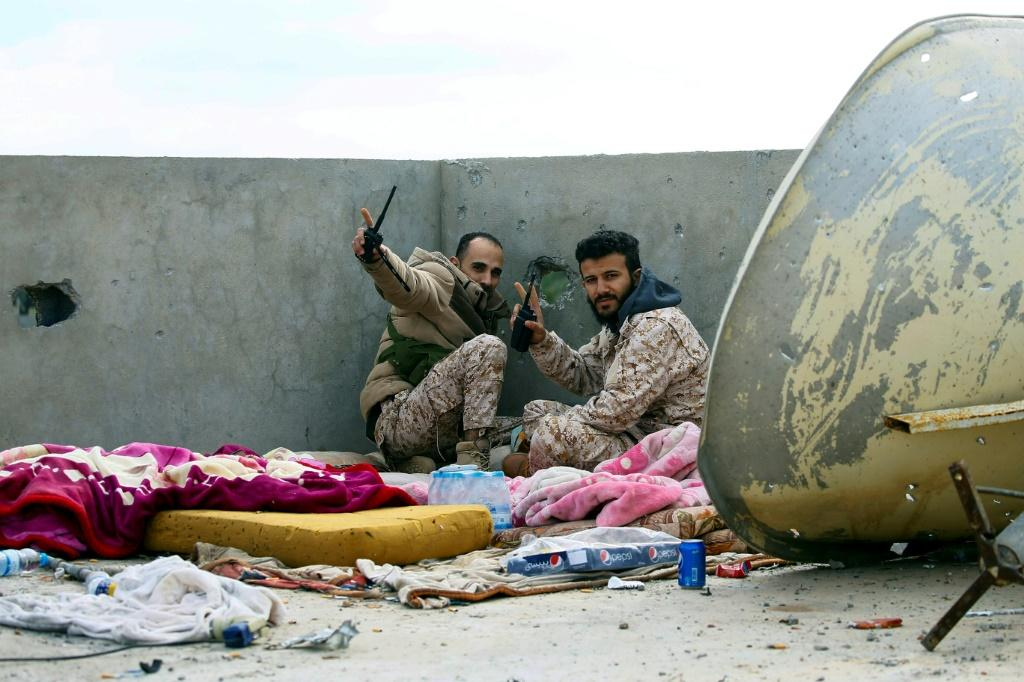 Fighters loyal to the internationally recognised Libyan Government of National Accord (GNA) on the roof of a building in an area south of the Libyan capital Tripoli