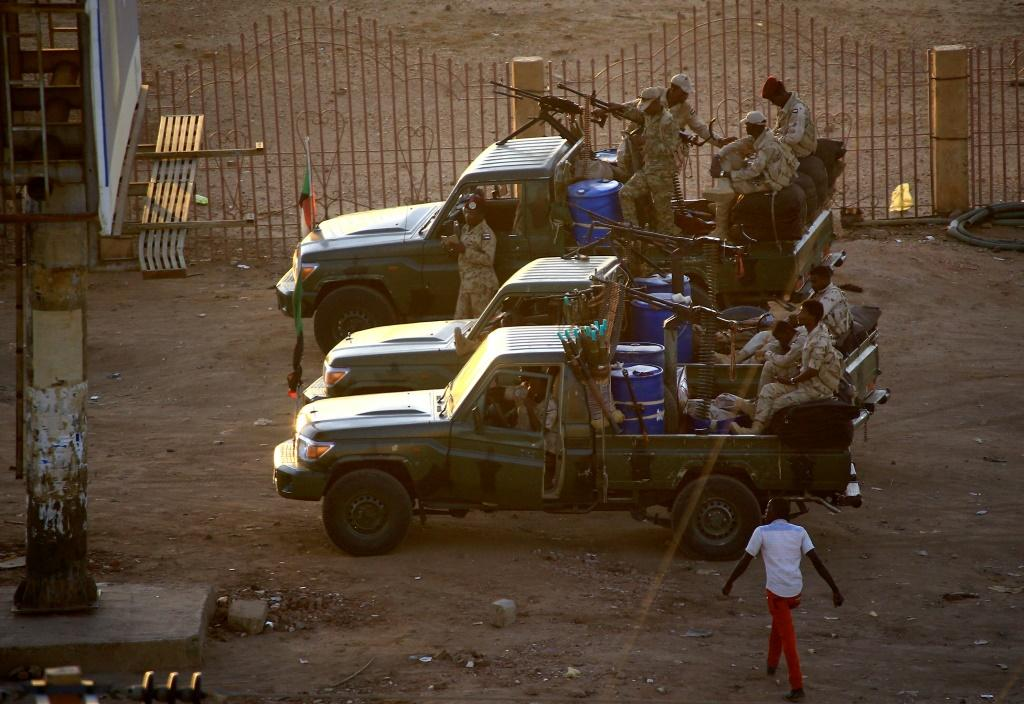 Members of Sudan's intelligence services shoot bullets in the air at the headquarters of the Directorate of General Intelligence Service in the Riyadh district of the capital Khartoum