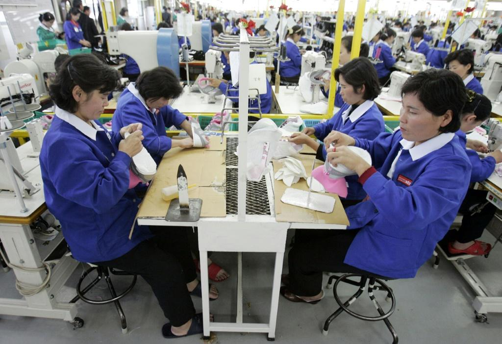 North Korean laborers work in 2007 at a shoe factory in the inter-Korean industrial park of Kaesong, which South Korea later shut down after rising tension with the North