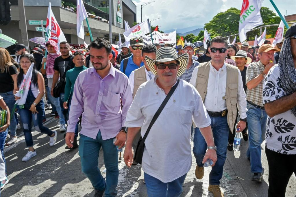 Rodrigo Londono aka Timochenko (C), seen here taking part in a general strike against the government Colombian President Ivan Duque in Medellin in November