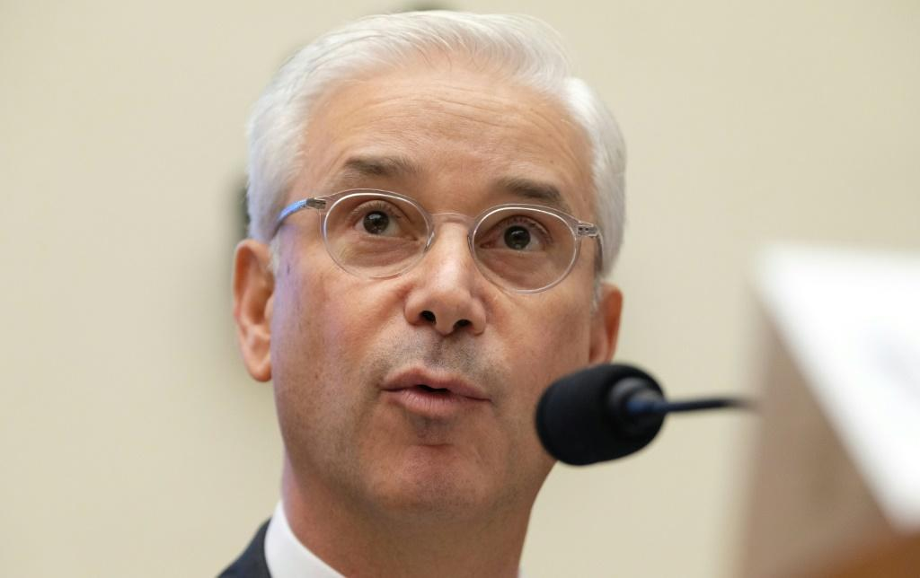 Wells Fargo Chief Executive Charles Scharf, shown here at a congressional hearing last year, cited high costs as he seeks to turn around the struggling bank