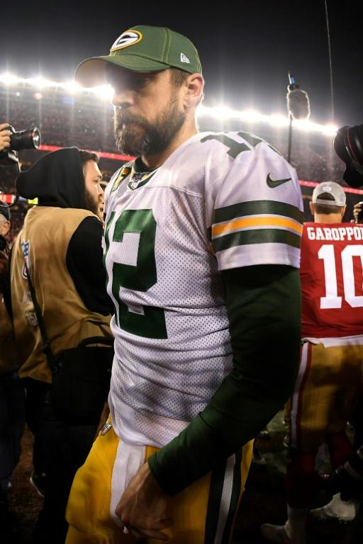 Green Bay great Aaron Rodgers walks off the field after the Packers came up short in the NFL's NFC Championship game against the San Francisco 49ers