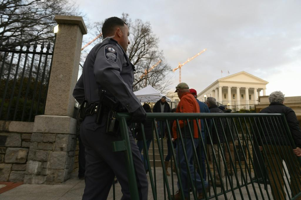 Virginia State Capitol police officers move barriers near one of the entrances to the State Capitol building in Richmond, ahead of a pro-gun rights rally