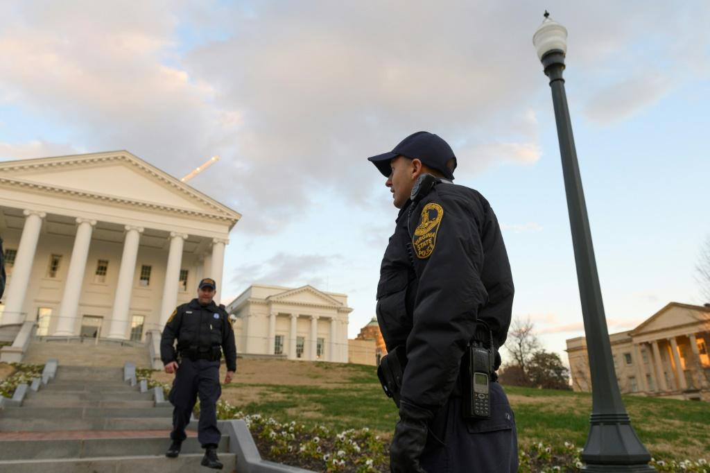 Virginia State police officers walk on the grounds of the State Capitol in Richmond, where security has been increased ahead of a pro-gun rights rally