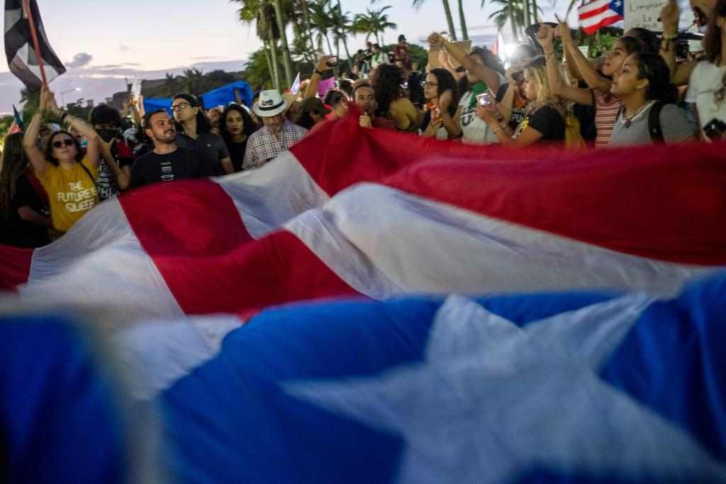 Protesters gather in front of Puerto Rico's Capitol against Governor Wanda Vazquez Garced and the government in San Juan after discovery of a warehouse filled with unused emergency supplies dating from Hurricane Maria in 2017