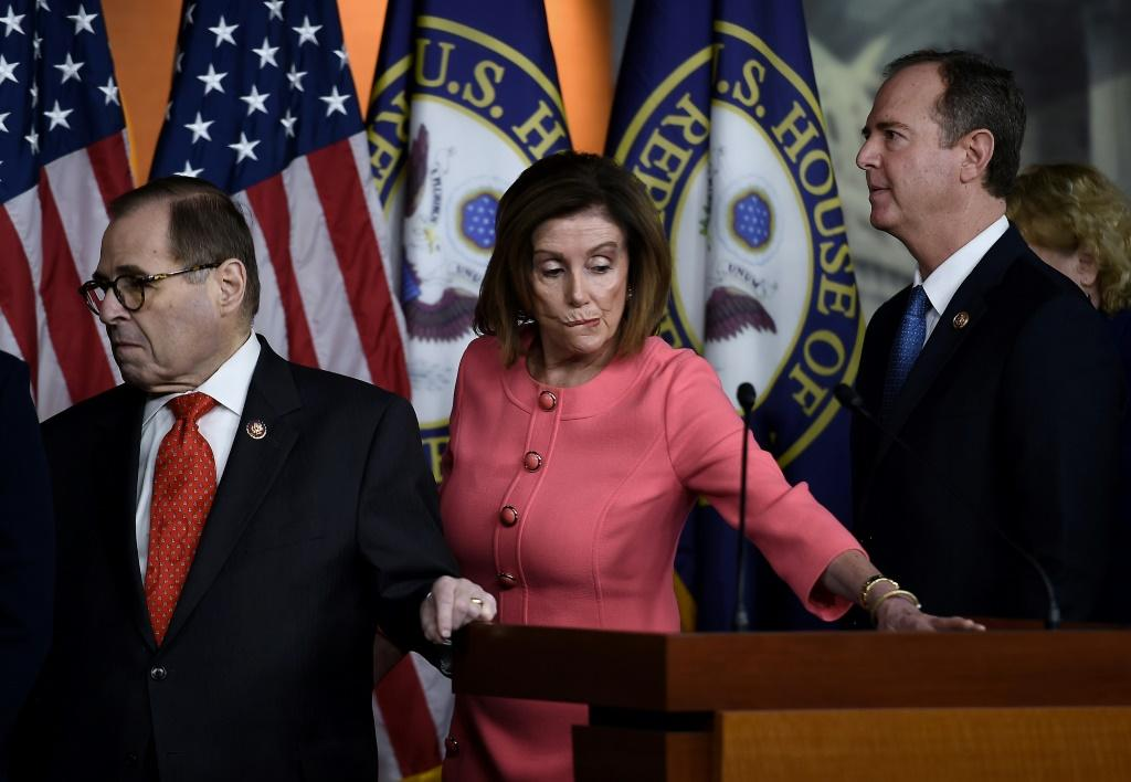 Speaker of the House Nancy Pelosi, flanked by Impeachment Managers Rep. Adam Schiff (R) and Rep. Jerry Nadler, leaves a press conference after annoncing the impeachment managers on Capitol Hill January 15, 2020