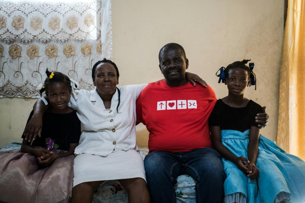Andrea Cledion (2L) poses with her husband and their two foster children, who they consider to be their daughters