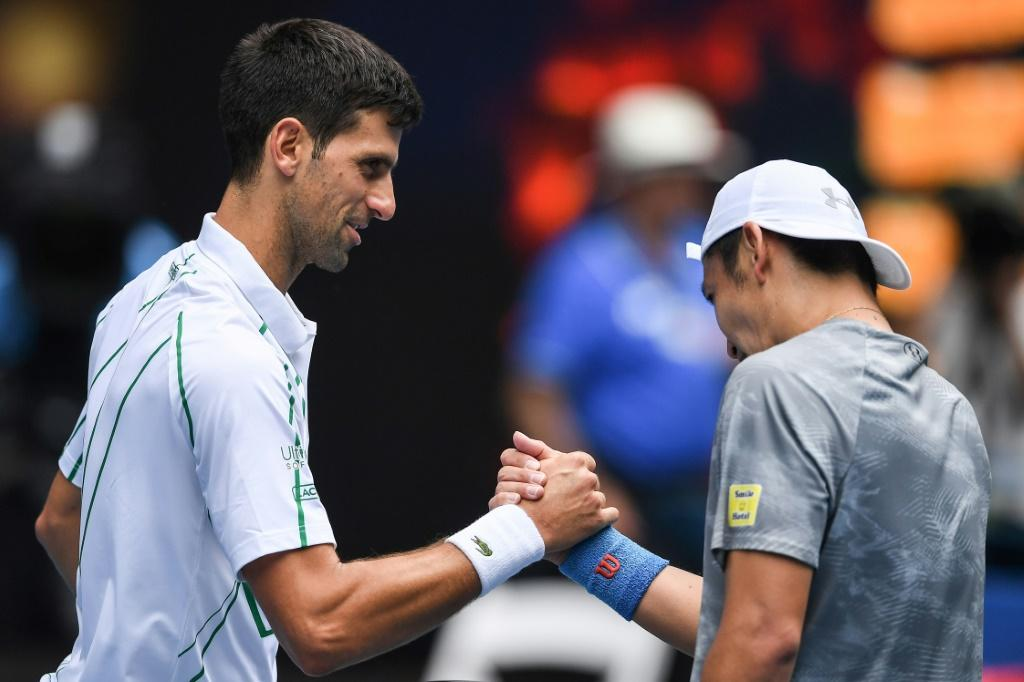 Serbia's Novak Djokovic weathered windy conditions in his won over Tatsuma Ito