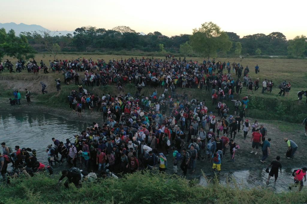Central American migrants - mostly Hondurans heading in a caravan to the US - crossing the Suchiate River from Guatelmala into Mexico