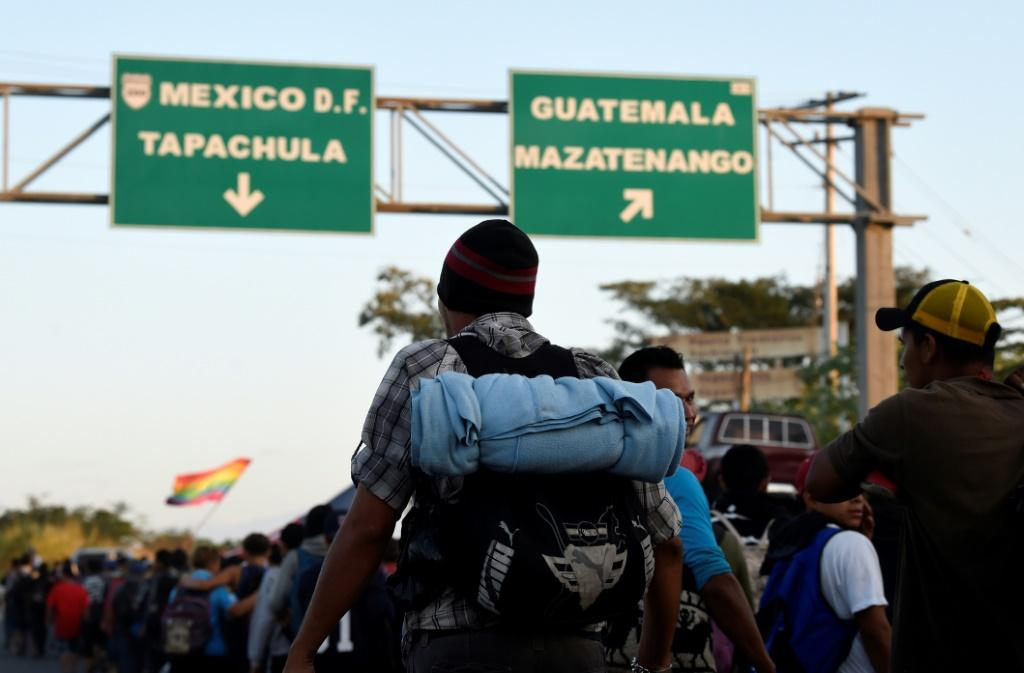 Migrants walking on the outskirts of Ciudad Hidalgo in Mexico's southern Chiapas State, after crossing the border from Guatemala
