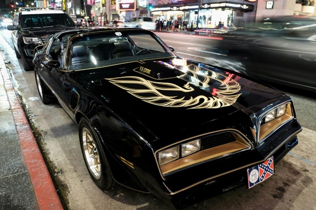 A Pontiac Firebird Trans Am that once belonged to late Hollywood star Burt Reynolds was among the luxury items seized from a husband and wife team charged in a solar power investment scam