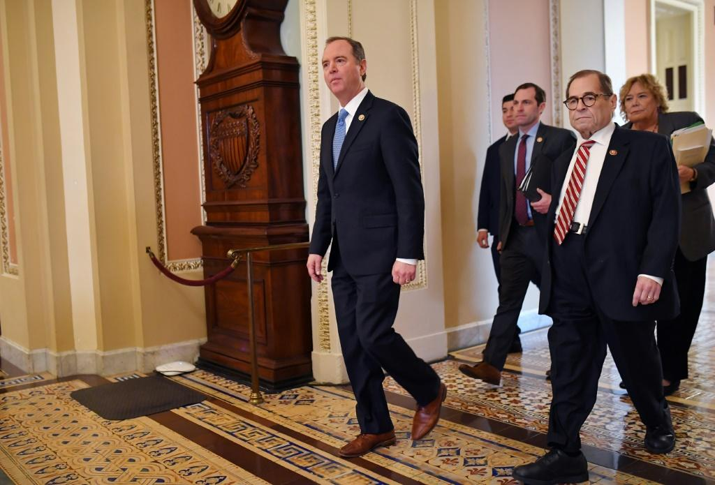 House Impeachment prosecutors, including Adam Schiff (L), Jerry Nadler (R) and Zoe Lofgren (R rear), are to offer evidence on the charge of obstruction of Congress before closing their case against President Donald Trump