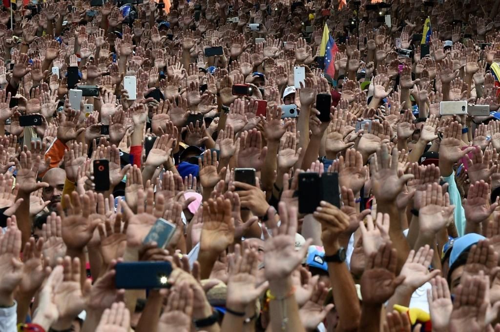 People attend a rally against President Nicolas Maduro in Caracas in January 2019