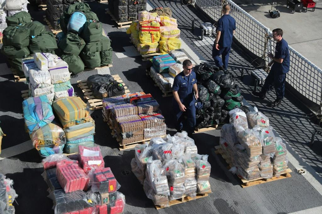 The US Coast Guard shows off cocaine and marijuana intercepted in more than a dozen separate raids in the Caribbean in October 2019